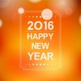 Feliz Año Nuevo 2016 en modelo de la llamarada del bokeh y de la lente en fondo de la naranja del verano Imágenes de archivo libres de regalías