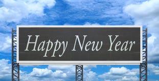 Feliz Año Nuevo en tablero grande de la muestra Foto de archivo libre de regalías