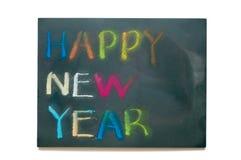 Feliz Año Nuevo en tablero negro Fotografía de archivo libre de regalías
