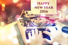 Feliz Año Nuevo en una máquina de escribir Foto de archivo libre de regalías
