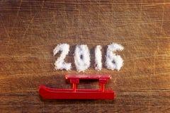 Feliz Año Nuevo 2016 escrita el azúcar Imagen de archivo libre de regalías