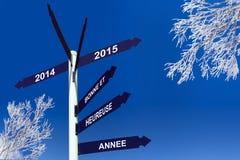 Feliz Año Nuevo 2015 escrita en francés en los paneles de la dirección Imágenes de archivo libres de regalías