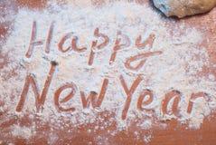 Feliz Año Nuevo escrita en la harina, Imágenes de archivo libres de regalías