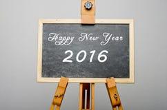 Feliz Año Nuevo 2016 escrita en la pizarra negra, pintura del caballete Fotos de archivo libres de regalías
