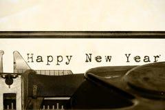 Feliz Año Nuevo escrita en una máquina de escribir vieja Foto de archivo