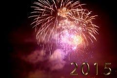 Feliz Año Nuevo 2015 - fuego artificial por noche Fotografía de archivo