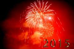 Feliz Año Nuevo 2015 - fuego artificial por noche Imágenes de archivo libres de regalías