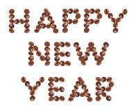 Feliz Año Nuevo, hecha del café de las habas Foto de archivo libre de regalías