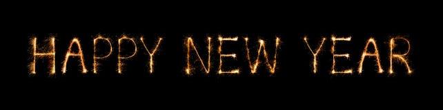 Feliz Año Nuevo hecha del fuego artificial de las chispas en la noche Foto de archivo libre de regalías