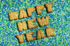 Feliz Año Nuevo La palabra de las letras comestibles miente en el gla Fotografía de archivo