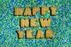 Feliz Año Nuevo La palabra de las letras comestibles miente en el gla Imágenes de archivo libres de regalías