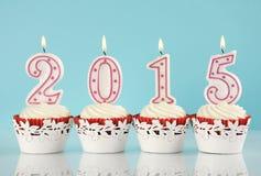 Feliz Año Nuevo para 2015 magdalenas rojas del terciopelo Imagen de archivo