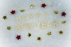 Feliz Año Nuevo que miente en la nieve Foto de archivo libre de regalías