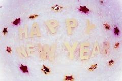 Feliz Año Nuevo que miente en la nieve Fotos de archivo libres de regalías