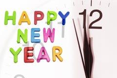 Feliz Año Nuevo y reloj Foto de archivo libre de regalías