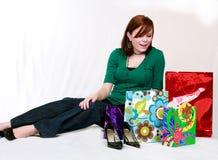 Feliz adolescente con los bolsos de compras Imagenes de archivo