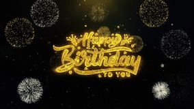 Feliz aniversario escrito as part?culas do ouro que explodem a exposi??o dos fogos de artif?cio