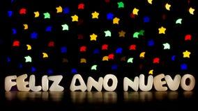 Feliz Ano Nuevo, Feliz Año Nuevo en lengua española Imagen de archivo libre de regalías