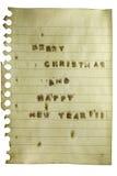 Feliz Chrismtas en la nota Foto de archivo