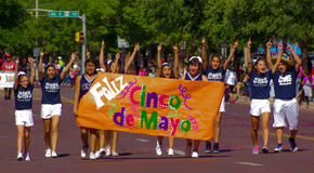 Feliz Cinco de Mayo. Young people celebrate Cinco De Mayo with a parade stock image