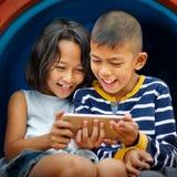 Feliz con tecnología Imagen de archivo libre de regalías