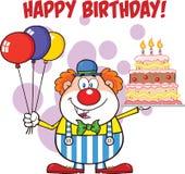 Feliz cumpleaños con los globos y la torta de Cartoon Character With del payaso con las velas Fotografía de archivo libre de regalías