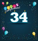 Feliz Cumpleanos 34 - Happy Birthday 34 in Spanish language - Greeting card with white candles. In the form of number with background of balloons and confetti Royalty Free Stock Photography