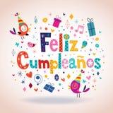 Feliz Cumpleanos - lycklig födelsedag i spanskt kort Fotografering för Bildbyråer