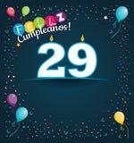 Feliz Cumpleanos 29 - lycklig födelsedag 29 i spanskt språk - hälsningkort med vita stearinljus Royaltyfri Fotografi