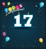 Feliz Cumpleanos 17 - lycklig födelsedag 17 i spanskt språk - hälsningkort med vita stearinljus Royaltyfri Foto