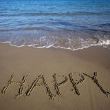 Feliz da palavra escrito na areia Foto de Stock Royalty Free