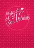 FELIZ DIA DE SAN VALENTIN - Happy Valentine`s Day in Spanish language - white lettering on a red background Stock Photography