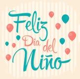 Feliz dia del nino - счастливый текст дня детей в испанском языке Стоковое фото RF