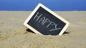 Feliz escrito na praia Fotos de Stock Royalty Free