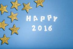 2016 feliz, estrellas en fondo azul Foto de archivo libre de regalías