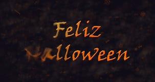 Feliz Halloween-Text in der spanischen Auflösung in Staub nach links Stockbild