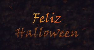 Feliz Halloween text in Spanish dissolving into dust to bottom Stock Images