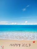 2017 feliz na areia Foto de Stock