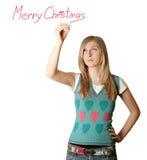 Feliz Natal da escrita da mulher Imagem de Stock Royalty Free