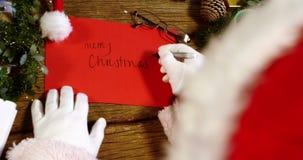 Feliz Natal da escrita de Papai Noel no cartão filme