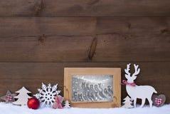 Feliz Natal de madeira do quadro da neve do fundo Imagens de Stock Royalty Free