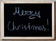 Feliz Natal escrito em um quadro-negro Fotos de Stock