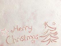 Feliz Natal escrito na neve branca Fotografia de Stock Royalty Free