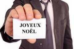 Feliz Natal escrito no francês em um cartão ilustração do vetor