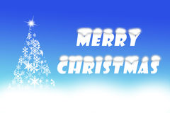Feliz Natal escrito no fundo dos azuis cobalto Imagens de Stock