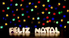 Feliz natal, merry christmas in Portuguese language. Text, beautiful multicolor bokeh background with copy space Stock Photos