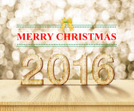 Feliz Natal 2016 na textura de madeira na sala da perspectiva com sp Imagem de Stock