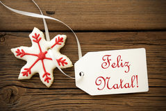 Feliz Natal, Portuguese Christmas Greetings. Feliz Natal, which is Portuguese and means Merry Christmas, on a Label with a red white Christmas Star Cookie Royalty Free Stock Photos