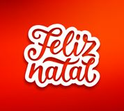 Feliz Natal modern calligraphic lettering. Feliz Natal portuguese Merry Christmas text on white paper label with carving over red background. Modern calligraphy Stock Image