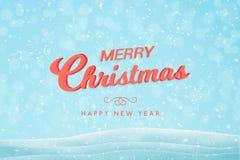 Feliz Natal que cumprimenta o texto no fundo azul com flocos de neve imagem de stock royalty free